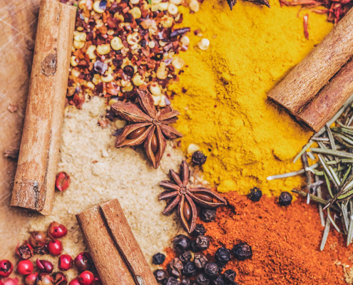 A colourful assortment of spices in whole and powdered form